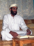 220px-Anwar_al-Awlaki_sitting_on_couch,_lightened.jpg
