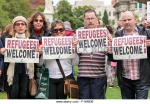 belfast-northern-ireland-uk-30th-aug-2015people-holding-refugees-welcome-f1w6db.jpg