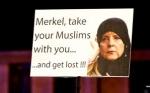 angela-merkel-to-pay-millions-muslim-migrants-voluntarily-leave-germany-isis-298x186.jpg